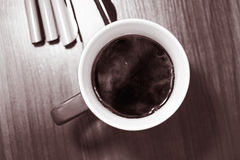 White Mug With Black Liquid on Top of Table Stock Photos