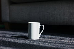 White mug on carpet at home Stock Images
