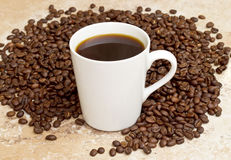 White mug with coffee Stock Images