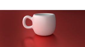 White mug cup on red desk Royalty Free Stock Image