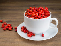 White mug filled with briar fruit Royalty Free Stock Photos