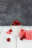 White mug of fresh cherries Royalty Free Stock Photo