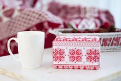 White mug with a gift on the table in the new year Stock Photo