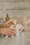 White mug with gingerbread house Stock Photo