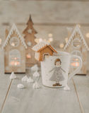 White mug with gingerbread house Royalty Free Stock Photos