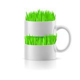 White mug with insertion of grass Stock Image
