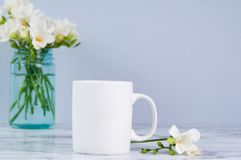 Spring mug. White mug mockup with pink tulips for spring Royalty Free Stock Image