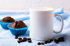 White Mug Mockup With Coffee Beans And Two Chocolate Muffins Royalty Free Stock Image