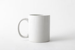 White mug in natural light. White ceramic mug in natural ligth, front view Royalty Free Stock Photography