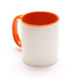 White mug with orange handle Royalty Free Stock Photo