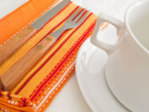 White mug and orange napkin. Stock Photography