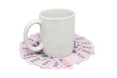 White mug over thai money isolated on white with clipping path Royalty Free Stock Image