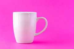 White mug on pink Royalty Free Stock Photos