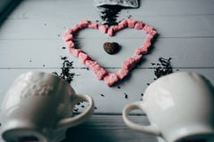 A white mug with pink heart stock image