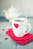 White mug with red heart Stock Image