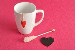 A white mug with a red heart royalty free stock photos
