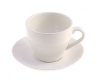 White mug with a saucer. On a white background Royalty Free Stock Photo
