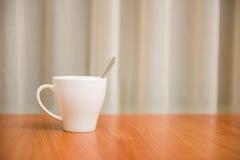White mug on table Royalty Free Stock Images