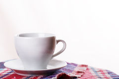 White mug tea coffee plaid Royalty Free Stock Images