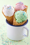 White mug with three ice cream cones Royalty Free Stock Photos