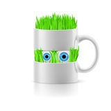 White mug of two parts with grass inside Stock Photos