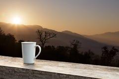 White mug on wood table with sunlight Stock Photo