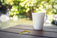White mug on a wooden table. Stock Images