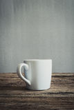 White mug on wooden tabletop Royalty Free Stock Images