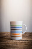 White mug on wooden tabletop Stock Photography