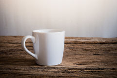 White mug on wooden tabletop Stock Photos