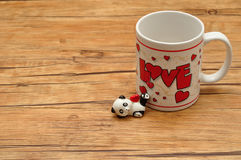 A white mug with the word love on it royalty free stock photo
