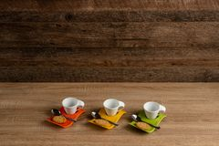 White mugs holding up for coffee, dark background stock images