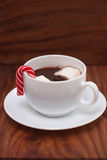 White mugs with hot chocolate, marshmallows and Christmas candy Stock Images