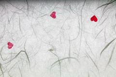 White mulberry paper with red hearts Royalty Free Stock Photos