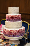White multi level wedding cake with pink flower decorations Stock Image