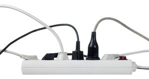 White multiple socket and plugs sideways Royalty Free Stock Photo