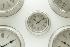 White multiple times clock hang on the wall. Timing or pass memory background concept stock photo