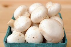 White mushroom in basket Stock Photo
