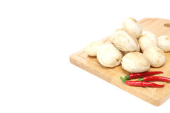 White mushroom on a cutting board Stock Photos
