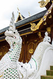 White naga statue with wood chapel in Thai temple Stock Photography