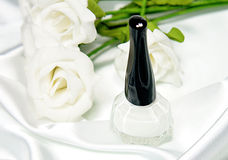 White nail polish and white roses Royalty Free Stock Images