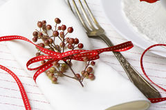 White napkin decorated with red ribbon Christmas plant, table se Royalty Free Stock Images