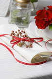 White napkin decorated with red ribbon Christmas plant, table se Stock Image