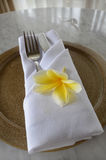White napkin fork and flower  Royalty Free Stock Photo
