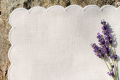 White napkin with lavender flowers. On old stone Stock Images