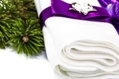 White napkin with ribbon and twig Christmas tree. Macro view of white napkin with ribbon and twig Christmas tree isolated on white background Stock Images