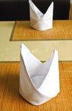 White napkins folded as triangles Royalty Free Stock Photo