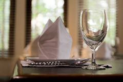 White Napkins Folded As Triangles On Plates With Wine Glass Royalty Free Stock Photo