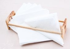 White napkins at wooden stand Stock Photos