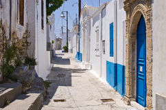 White narrow street of Koskinou, Rhodes, Greece Stock Photos